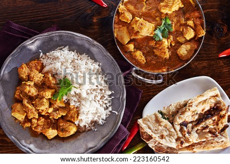 indian curry meal with balti dish, naan, and basmati rice - stock photo