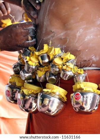 Indian devotee's body piercing ceremony - stock photo
