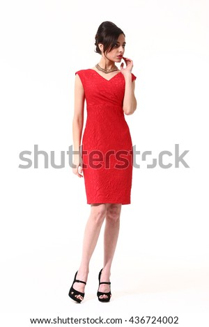 indian eastern brunette business executive woman with up do hair style in summer formal party decollete sleeveless red cocktail dress high heel sandals shoes going full body length isolated on white - stock photo