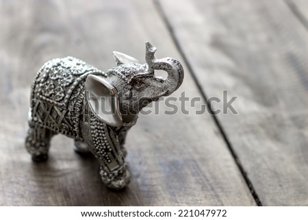 Indian Elephant Figurine on wooden table, close up - stock photo