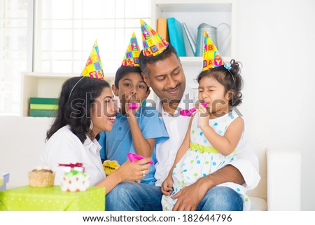 indian family birthday celebration with son and daughter - stock photo