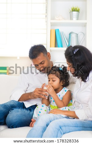 indian family drinking milk daugther