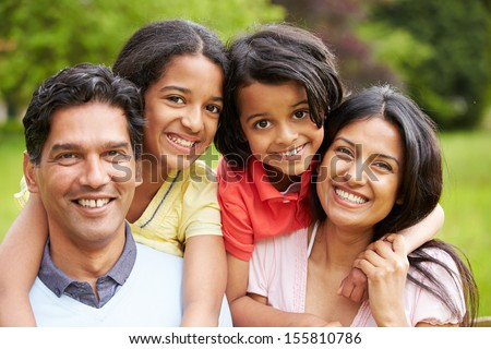 Indian Family Walking In Countryside - stock photo