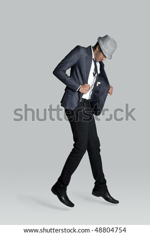 Indian fashion model lifts off the ground in studio - stock photo