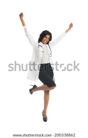 indian female doctor jumping in joy - stock photo