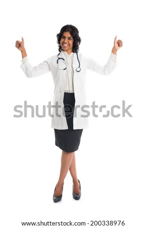 indian female doctor two thumbs up - stock photo