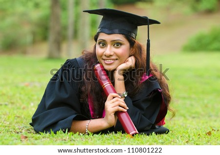 indian female graduate laying - stock photo
