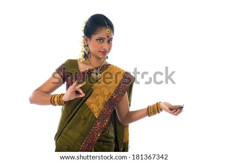 indian female in traditional clothes with lamp - stock photo