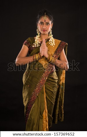 indian female in traditional saree dress and diwali greeting  - stock photo