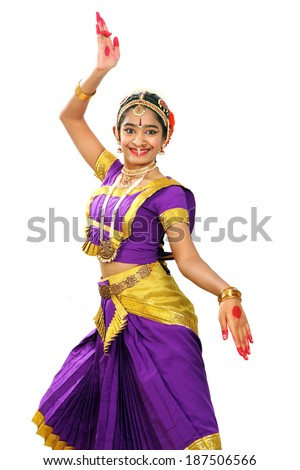 Indian female performing Bharathanatyam doing the action of  description of a king in violet  color costumes. - stock photo