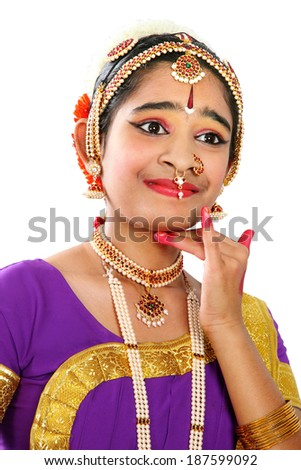 Indian female performing Bharathanatyam doing the action of expectation  in violet color costumes