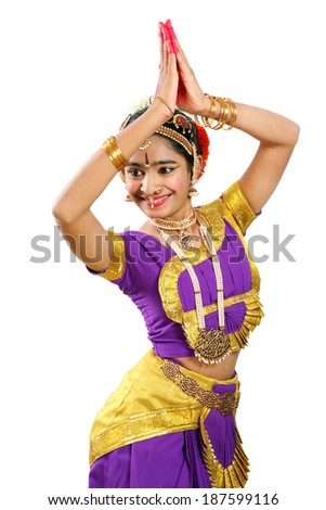 Indian female performing Bharathanatyam doing the action of Greeting in violet color costumes  - stock photo