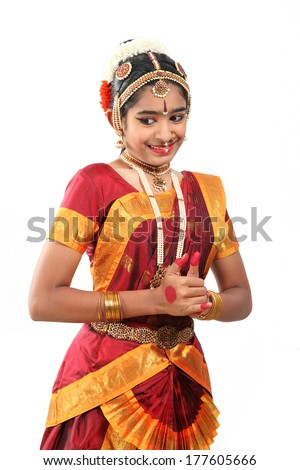 Indian female performing Bharathanatyam  doing the action of happiness and love or shringara. - stock photo