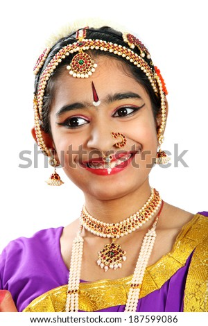 Indian female performing Bharathanatyam doing the action of  happiness  in violet color costumes  - stock photo