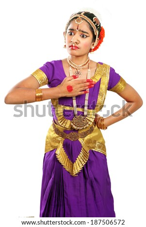 Indian female performing Bharathanatyam doing the action of   why me  in violet  color costumes. - stock photo