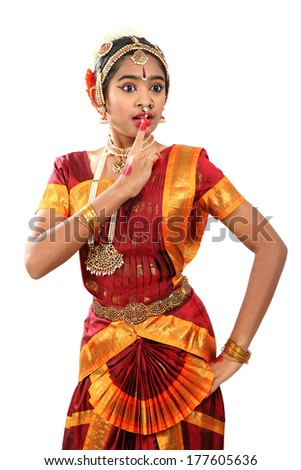 Indian female performing Bharathanatyam  doing the action of wonder and surprise or adhbudha - stock photo