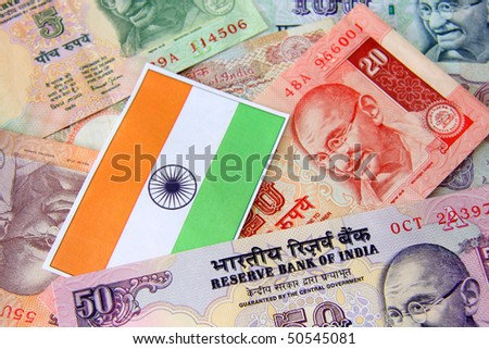 Indian flag and Indian currency concept of growing economy - stock photo