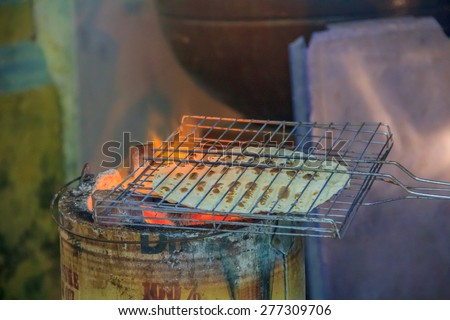 Indian flat bread roasted in the street of Georgetown, Penang, Malaysia. Penang is a well known street food capital of South East Asia - stock photo