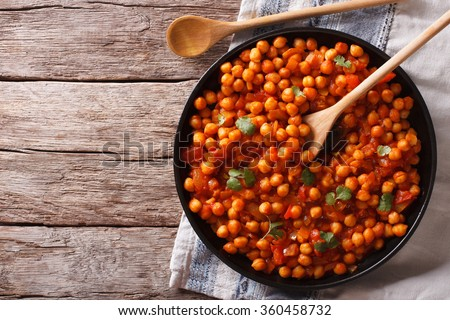 Indian Food Chana masala on a plate on the table. Horizontal top view