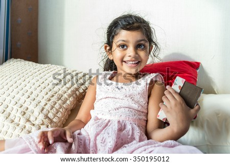 Indian girl hold with her present box - stock photo