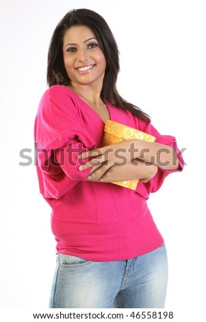 indian girl hugging her giftbox - stock photo