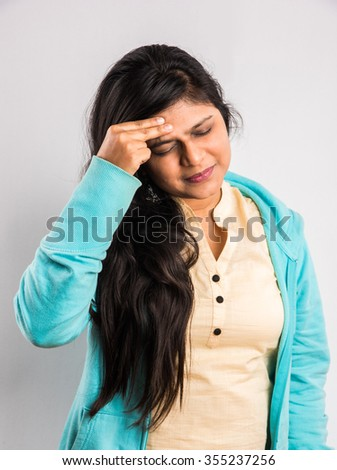 indian girl with headache, asian girl with headache, indian woman with headache holding her hand to the head, isolated on white, working woman & headache, indian woman & migraine, indian girl in pain - stock photo