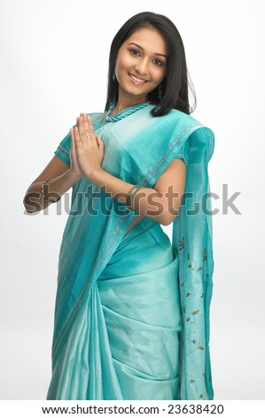 Indian girl with sari in welcome posture - stock photo