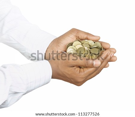 Indian Gold Coins in Hands - stock photo