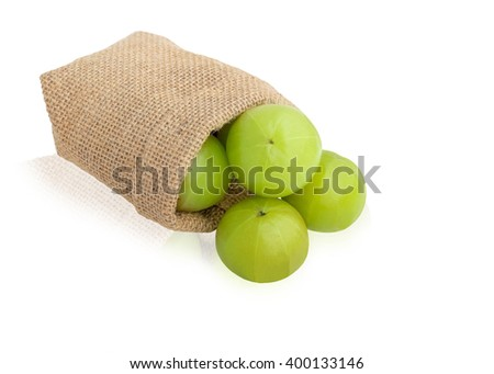 Indian gooseberry green fruits in sackcloth bag  isolated on white background. This has clipping path.