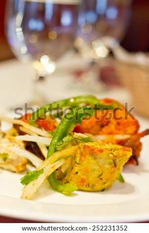 Indian grilled chicken with sliced green peppers bean sprouts and onions - stock photo