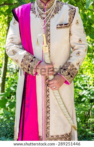 Indian groom in traditional outfit. - stock photo