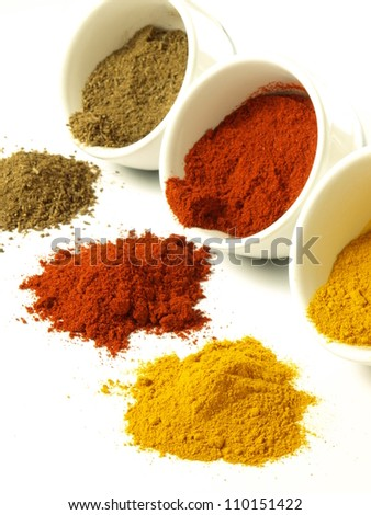 Indian ground spices: cumin, turmeric and pepper - stock photo