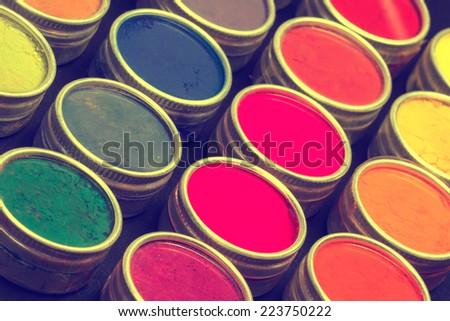 Indian Holi festival colours background. Toned image - stock photo