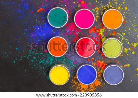 Indian Holi festival colours with copy space - stock photo