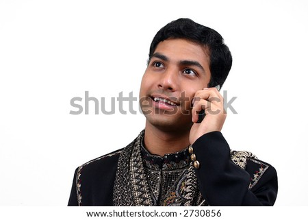 Indian in traditional clothing talking in a phone 2 - stock photo