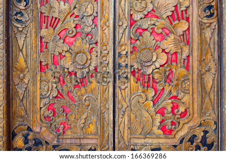 Indian inspired carved colorful golden red wooden door - stock photo