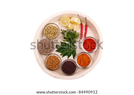 Indian kitchen spices and herbs on a plate - stock photo