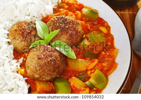 Indian koftas or meatballs, with spicy tomato sauce and Basmati rice. - stock photo