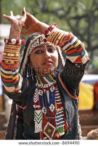 Indian lady dancing in traditional dress of a Rajasthani gypsy