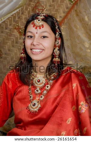Indian lady wearing traditional sari and bridal jewelry - stock photo