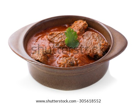 indian lamb rogan josh served in pottery isolated on white background - stock photo