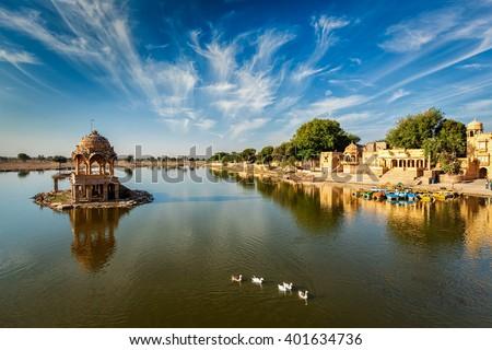 Indian landmark Gadi Sagar - artificial lake with white swans. Jaisalmer, Rajasthan, India - stock photo