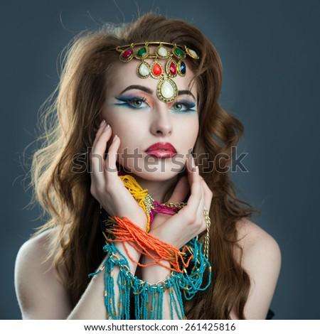 Indian look like woman with costume  jewelery. - stock photo