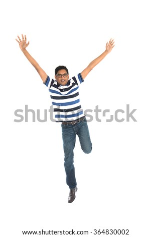 indian male jumping in joy - stock photo