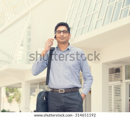 indian male over on a phone conversation - stock photo
