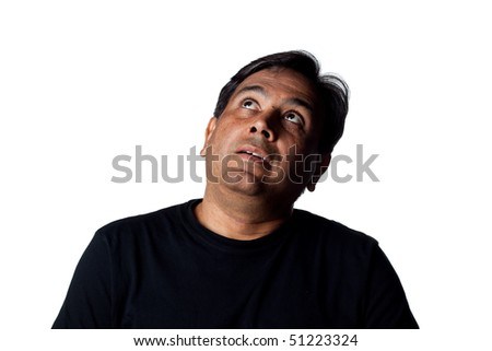 Indian man looking to the heavens, studio shot - stock photo