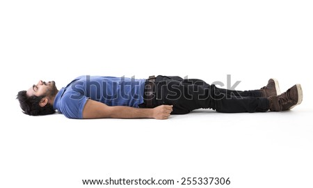 Indian man lying on floor. Full-length image. Isolated on white background. - stock photo