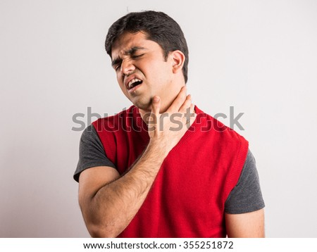 indian man with neck pain, asian man with neck pain - stock photo