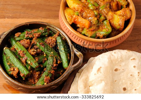 Indian masala bhindi and masala mixed vegetable curry with roti or Indian bread