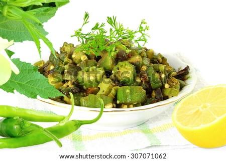Indian masala fried okra bhindi or ladyfinger curry - stock photo